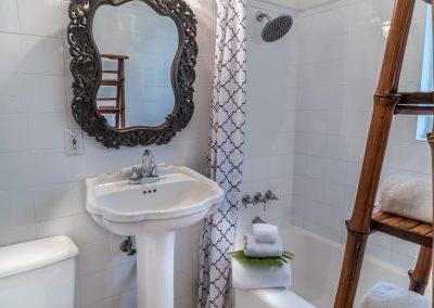 Bath next to queen bedroom