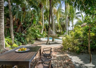 Beautiful vacation backyard with dining area