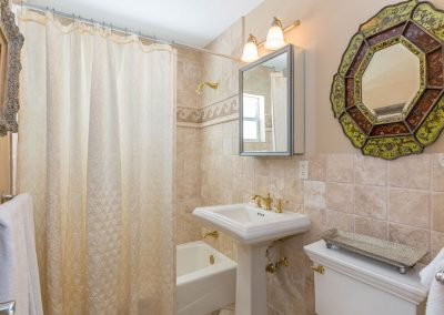 Queen bathroom with beautiful tiled walls